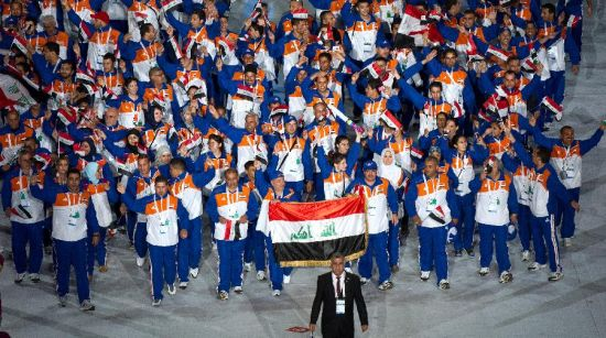 The Iraqi delegation takes part in the opening ceremony of the 12th Arab Games in Doha, capital of Qatar, Dec. 9, 2011. (Xinhua/Chen Shaojin)