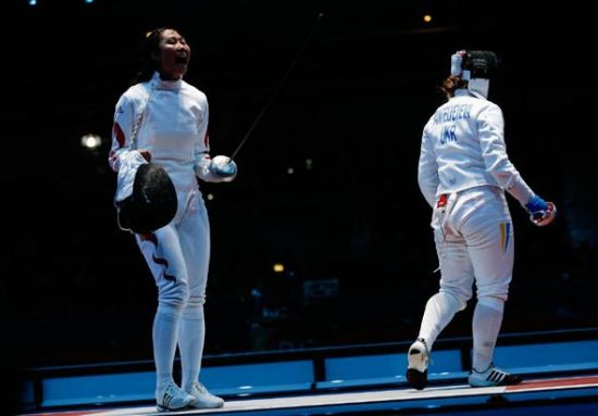 She was born in Dandong, Liaoning province, on March 9, 1981. At the London Olympics, she won a gold medal in the women's epee team final. This is her fourth time to participate in the Olympics. [Photo/Xinhua]