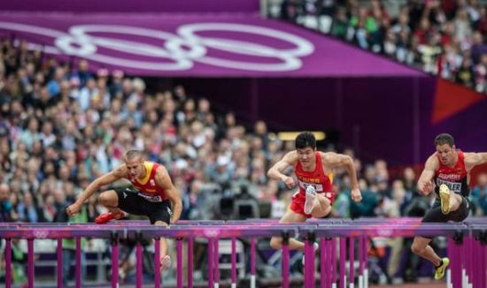 Shi was born in Baoding, Hebei province. He has attended the Olympic Games for three times. Although he hasn't won any medals at the Games, he is regarded as one of the best hurdlers in Asia. [Photo/Xinhua]