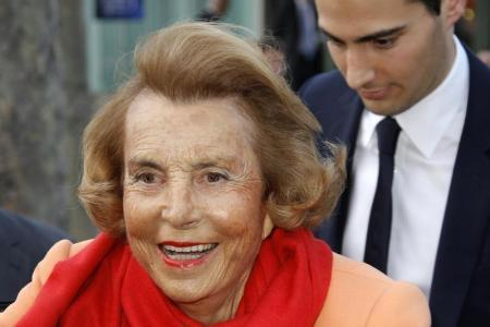 #9 - Liliane Bettencourt and family.CAPTION: Liliane Bettencourt (L), heiress to the L'Oreal fortune leaves with Jean-Victor Meyers, her grandson, the L'Oreal-UNESCO prize for women in Paris, March 29, 2012. (Photo:agencies)