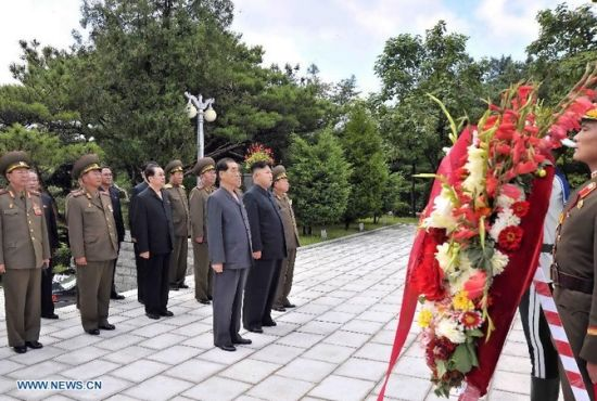 Photo taken on July 29, 2013 shows Kim Jong Un, top leader of the Democratic People's Republic of Korea (DPRK), visiting a cemetery in Hoechang County, South Phyongan Province, DPRK. Kim Jong Un, top leader of the Democratic People's Republic of Korea (DPRK), visited a cemetery on Monday to mourn fallen Chinese fighters in the Korean War, the official news agency KCNA reported on Tuesday. (Xinhua/KCNA)