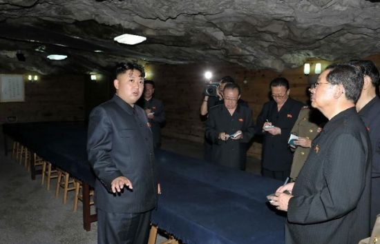 Photo taken on July 29, 2013 shows Kim Jong Un (L), top leader of the Democratic People's Republic of Korea (DPRK), visiting the Songhung Revolutionary Site in Hoechang County, South Phyongan Province, DPRK. Kim Jong Un, top leader of the Democratic People's Republic of Korea (DPRK), visited a cemetery on Monday to mourn fallen Chinese fighters in the Korean War, the official news agency KCNA reported on Tuesday. (Xinhua/KCNA)