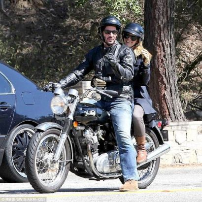 Who needs The Fonz? A leather clad Keanu Reeves took a female friend