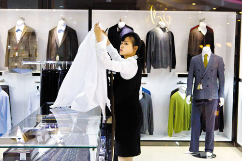 This May 19, 2013 photo shows a boutique selling Italian suits at the newly-opened Haedanghwa mall in Pyongyang, North Korea. /AP