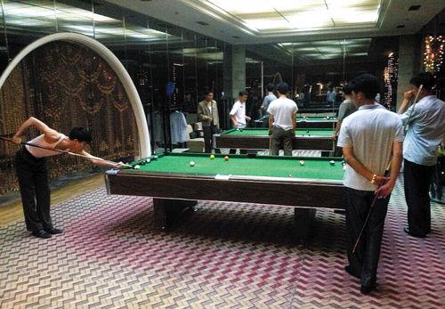 In this picture tweeted by CNN's Ivan Watson on, North Korean men play snooker in Pyongyang.(Photo:Agencies)