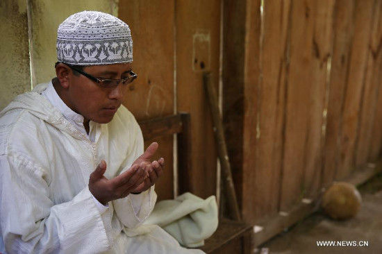 A photo taken on Aug. 2, 2013 shows an indigenous Muslim man praying during the holy month of Ramadan, at Al Kauthar mosque, in San Cristobal de Las Casas, Mexico. Indigenous Tzotzil who are converted to Islam, celebrate the holy month of Ramadan, making fast from dawn to sunset in San Cristobal de Las Casas, Chiapas, where Islam was brought to Mexico in 1994 by Spanish people. Some indigenous Muslims travel to Mecca and other Arab cities to study the Koran and teach it to their community. (Xinhua/Daniel Cardenas)