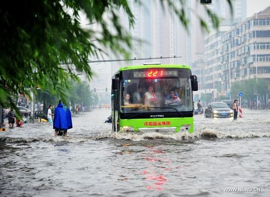A bus moves on a waterlogged street in Shenyang, capital of northeast China's Liaoning Province, Aug. 16, 2013. Some parts of Shenyang were waterlogged due to downpour caused by thunderstorms Friday. (Xinhua/Zhang Wenkui)