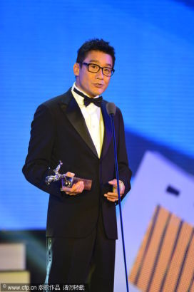 Chinese actor Tony Leung receives Best Actor Award at the 13th Chinese Filmi Media Awards in Quanzhou, Fujian province on August 18, 2013.