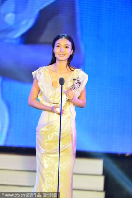Chinese actress Xi Qi receives Best New Performer Awards at the 13th Chinese Film Media Awards in Quanzhou, Fujian province on August 18, 2013.