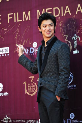 Chinese actor Berlin Chen arrives at the 13th Chinese Film Media Awards in Quanzhou, Fujian province on August 18, 2013. Chen won the Outstanding Performance Award. [Photo/CFP]