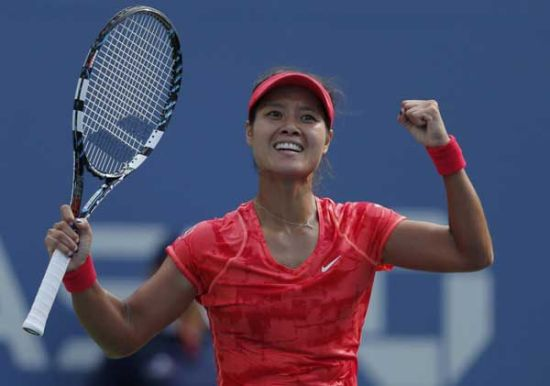Li Na of China celebrates after defeating Ekaterina Makarova of Russia at the US Open tennis championships in New York, Sept 3, 2013.[Photo/Agencies]