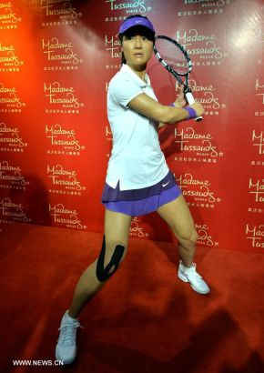 Photo taken on Sept. 12, 2013 shows the wax figure of China's top women tennis player Li Na at the Madame Tussauds in Wuhan, capital of central China's Hubei Province. Li on Thursday became the first Asian sport star to have a wax figure in the Wuhan Madame Tussauds. (Xinhua)