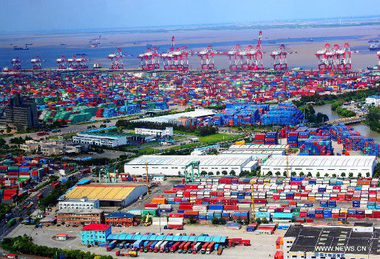 Photo taken on Sept. 26, 2013 shows the Waigaoqiao Free Trade Zone, part of the free trade zone (FTZ) in Shanghai, east China. China will officially launch the pilot FTZ in Shanghai on Sept. 29, taking a solid step forward to boost reforms in the world's second-largest economy. Covering almost 29 square kilometers, the zone will be created modeled on existing free trade businesses in the country's economic hub. (Xinhua/Chen Fei)