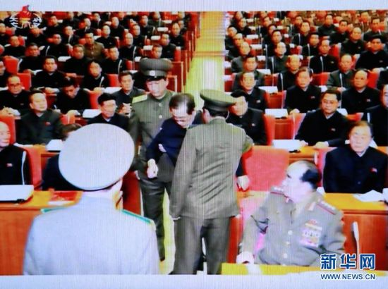 A screen capture from North Korea's Korean Central Television (KCTV) Broadcasting Station shows North Korean leader Kim Jong-Un's uncle Jang Song-thaek being arrested during an enlarged meeting of the Political Bureau of the Central Committee of the Workers' Party in Pyongyang, North Korea. [Photo: Xinhua]