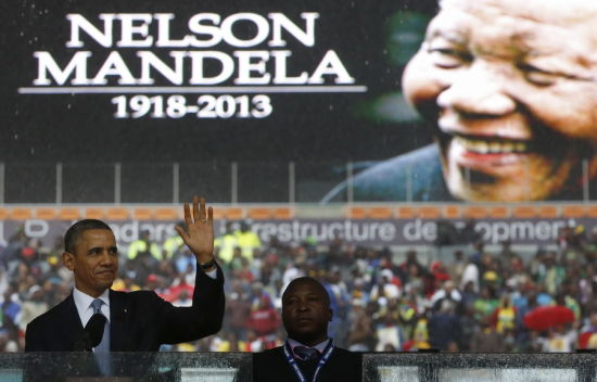U.S. President Barack Obama addresses the crowd during a memorial service for Nelson Mandela at FNB Stadium in Johannesburg, South Africa December 10, 2013. [Photo/Agencies]