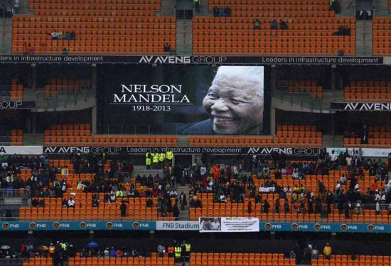 A picture of former South African President Nelson Mandela is shown on a giant screen at the First National Bank (FNB) Stadium, also known as Soccer City, ahead of Mandela's national memorial service in Johannesburg December 10, 2013. World leaders from U.S. President Barack Obama to Cuba's Raul Castro joined thousands of South Africans to honour Mandela on Tuesday in a memorial that will celebrate his gift for uniting enemies across political and racial divides. [Photo/Agencies]