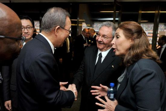 UN Secretary General Ban Ki-moon (left) shakes hands with Cuba's President Raul Castro Ruz (2nd right) at the memorial service for Nelson Mandela at the Soccer City Stadium in Johannesburg on December 10, 2013