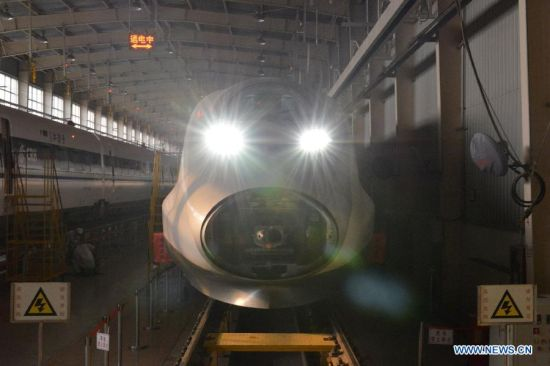 A static electricity test is conducted after the assembly of a CRH380A high-speed train in the manufacturing plant of Qingdao Sifang Co. Ltd., in Qingdao, east China's Shandong Province, Jan. 3, 2014.