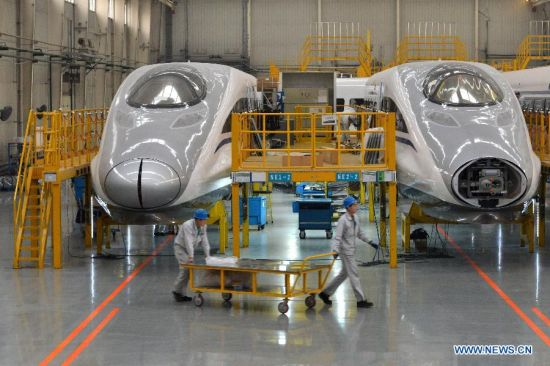 The heads of two CRH380A high-speed trains are seen in the manufacturing plant of Qingdao Sifang Co. Ltd., in Qingdao, east China's Shandong Province, Jan. 3, 2014.