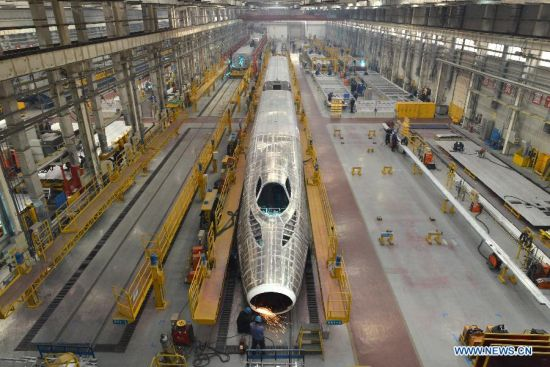 A CRH380A high-speed train is assembled in the manufacturing plant of Qingdao Sifang Co. Ltd., in Qingdao, east China's Shandong Province, Jan. 3, 2014.