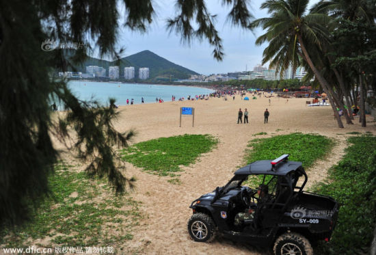 Armed police patrol public beaches in Sanya