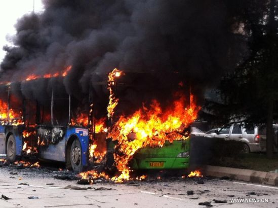 Photo taken with a mobile phone on Feb. 27, 2014 shows the bus fire scene in Guiyang, capital of southwest China's Guizhou Province. A bus bursted into flames on Jinyang South Road in Guiyang Thursday, leaving five people dead so far. (Xinhua)