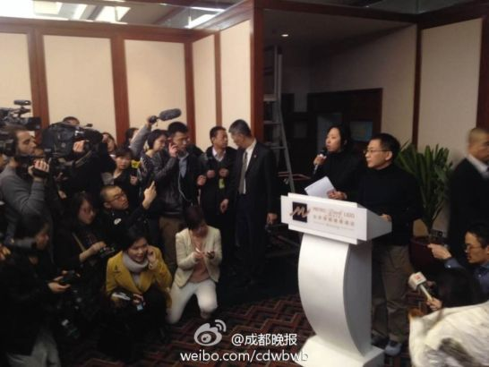 A Malaysia Airlines spokesman speaks to journalists