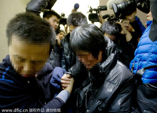 A relative of a passenger onboard Malaysia Airlines flight MH370 cries at Lido Hotel in Beijing, March 9, 2014.[Photo/icpress.cn]