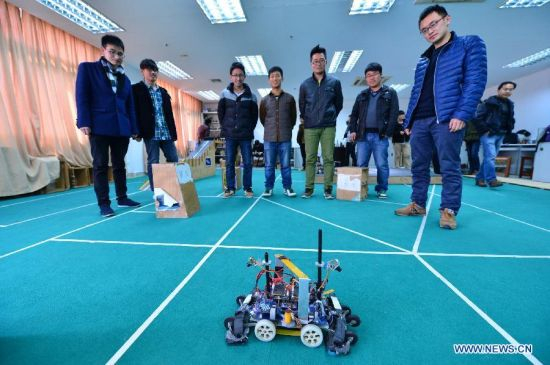 Students from a robot design team demonstrate a robot with automatic identification of climbing routes in Nantong University, Nantong, east China's Jiangsu Province, March 11, 2014. Students demonstrate the award-winning projects of the latest China Robot Competition at school's laboratory on Tuesday. (Xinhua/Shen Peng)
