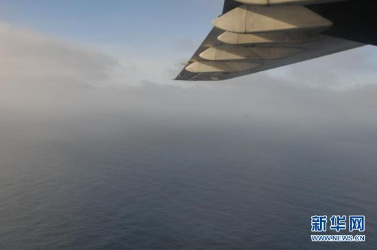 A Chinese plane on Monday spotted a white, square-shaped object in an area identified by satellite imagery as containing possible debris from the missing Malaysian airliner