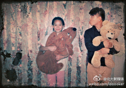 The picture shows the adult Wan and his child girlfriend are playing together with toys in their arms.