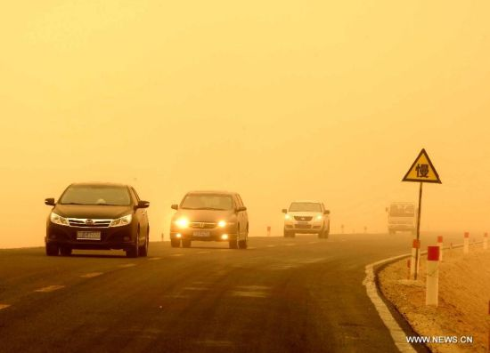 Vehicles run in a sandstorm on the outskirt of Guazhou, Jiuquan, northwest China's Gansu Province, April 23, 2014. Parts of Gansu was hit by a sandstorm Wednesday afternoon, which reduced visibility to less than 50 meters, according to the provincial meteorological center. (Xinhua/Nie Jianjiang)