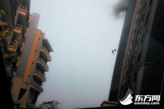 TWO young firefighters died after falling from the 13th floor of a downtown apartment block in Shanghai