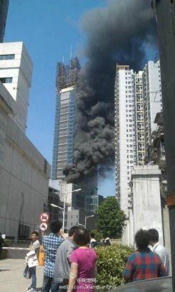 High-rise catches fire in central China city