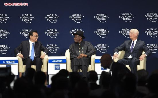 Chinese Premier Li Keqiang (L) attends the World Economic Forum on Africa in Abuja, Nigeria, May 8, 2014. (Xinhua/Li Xueren)