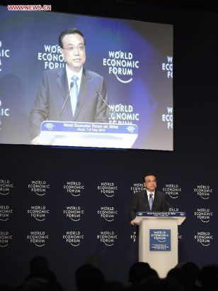 Chinese Premier Li Keqiang delivers a speech at the World Economic Forum on Africa in Abuja, Nigeria, May 8, 2014. (Xinhua/Li Xueren)