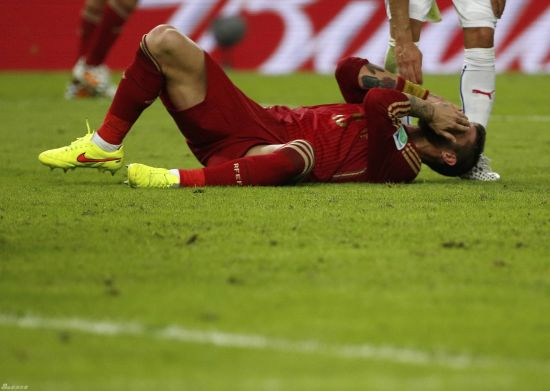 Spain crash out after Chile loss