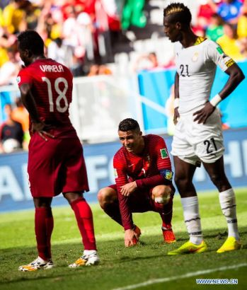 Portugal's Cristiano Ronaldo (C) reacts during a Group G match between Portugal and Ghana of 2014 FIFA World Cup at the Estadio Nacional Stadium in Brasilia, Brazil, June 26, 2014.Portugal won 2-1 over Ghana on Thursday. (Xinhua/Liu Bin)