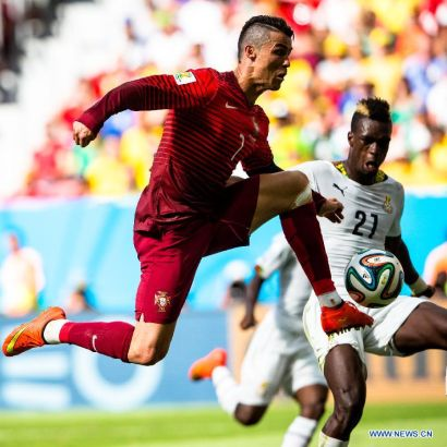 Portugal's Cristiano Ronaldo vies with Ghana's John Boye during a Group G match between Portugal and Ghana of 2014 FIFA World Cup at the Estadio Nacional Stadium in Brasilia, Brazil, June 26, 2014.Portugal won 2-1 over Ghana on Thursday. (Xinhua/Liu Bin)