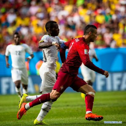 Portugal's Cristiano Ronaldo vies for the ball during a Group G match between Portugal and Ghana of 2014 FIFA World Cup at the Estadio Nacional Stadium in Brasilia, Brazil, June 26, 2014.Portugal won 2-1 over Ghana on Thursday. (Xinhua/Liu Bin)