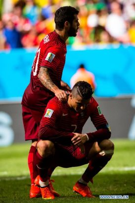 Portugal's Cristiano Ronaldo (down) reacts during a Group G match between Portugal and Ghana of 2014 FIFA World Cup at the Estadio Nacional Stadium in Brasilia, Brazil, June 26, 2014.Portugal won 2-1 over Ghana on Thursday. (Xinhua/Liu Bin)