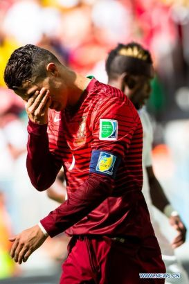 Portugal's Cristiano Ronaldo reacts during a Group G match between Portugal and Ghana of 2014 FIFA World Cup at the Estadio Nacional Stadium in Brasilia, Brazil, June 26, 2014.Portugal won 2-1 over Ghana on Thursday. (Xinhua/Liu Bin)