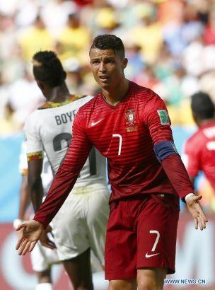 Portugal's Cristiano Ronaldo reacts during a Group G match between Portugal and Ghana of 2014 FIFA World Cup at the Estadio Nacional Stadium in Brasilia, Brazil, June 26, 2014. (Xinhua/Liu Bin)