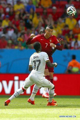 Portugal's Cristiano Ronaldo vies with Ghana's Mohammed Rabiu during a Group G match between Portugal and Ghana of 2014 FIFA World Cup at the Estadio Nacional Stadium in Brasilia, Brazil, June 26, 2014. (Xinhua/Liu Bin)