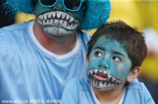 A young fan has his face painted like Luis Suarez while watching the match against Colombia, June28, 2014. [Photo/IC]