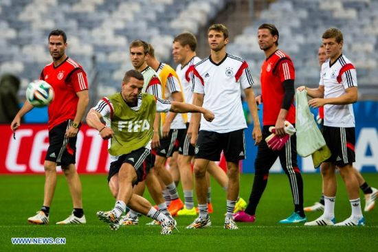Players of Germany take part in a training session in Belo Horizonte, Brazil, on July 7, 2014. Germany will play Brazil in their 2014 World Cup semifinal here on July 8. (Xinhua/Liu Bin)