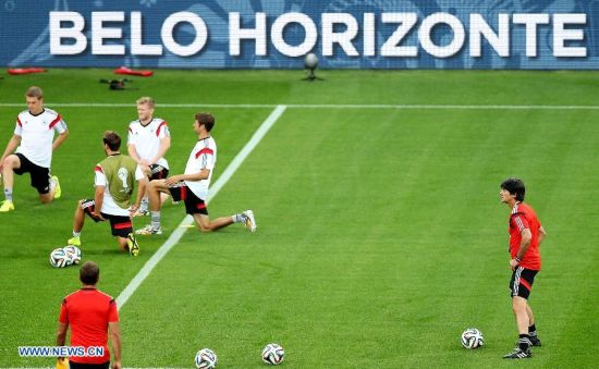 Joachim Loew (1st R), head coach of Germany takes part in a training session in Belo Horizonte, Brazil, on July 7, 2014. Germany will play Brazil in their 2014 World Cup semifinal here on July 8. (Xinhua/Li Ming)