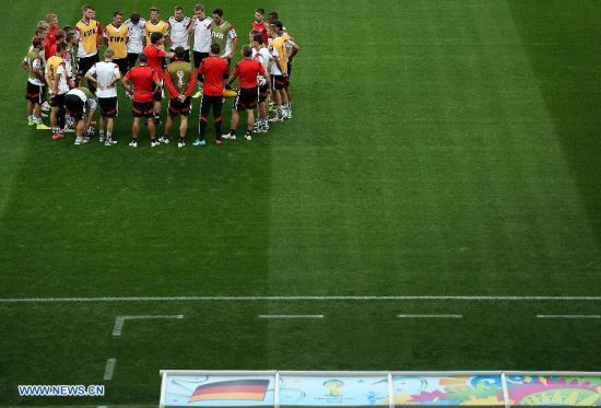 Players of Germany gather together ahead of a training session in Belo Horizonte, Brazil, on July 7, 2014. Germany will play Brazil in their 2014 World Cup semifinal here on July 8. (Xinhua/Li Ming)