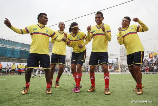 Athletes of Colombia celebrate after scoring against Germany during Street Football World Cup in Sao Paulo, Brazil, on July 7, 2014. This sports event attracted around 300 youngsters from 20 countries and regions all over the world. Differing from the conventional football match, the Street Football World Cup allowed athletes of different sexes to play together and there are no arbitrators. (Xinhua/Rahel Patrasso)