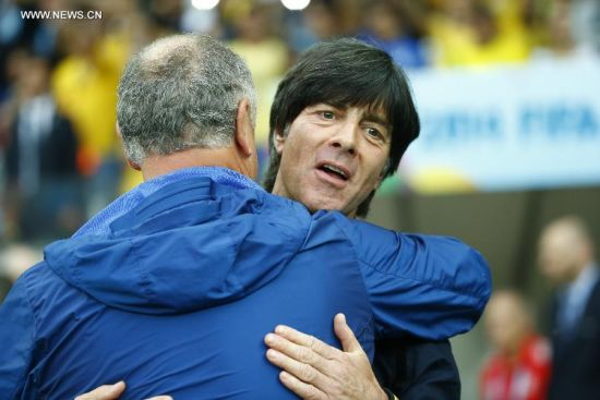 Brazil's coach Luiz Felipe Scolari (L) greets Germany's coach Joachim Loew before a semifinal match between Brazil and Germany of 2014 FIFA World Cup at the Estadio Mineirao Stadium in Belo Horizonte, Brazil, on July 8, 2014.(Xinhua/Chen Jianli)